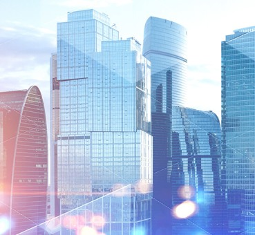 Panoramic view of modern cityscape with skyscrapers and glass towers with double exposure of triangular pattern for expert insights with joe killinger