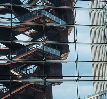 Image of the glass facade of one of the Hudson Yards buildings