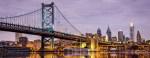 bridge stretching toward Philadelphia skyline