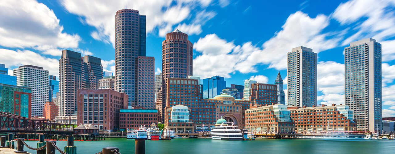 A wide shot of the Boston skyline and waterfront