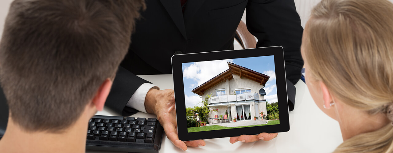 broker showing house to couple
