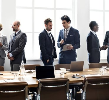 Image of a diverse group of business professionals collaborating at a meeting