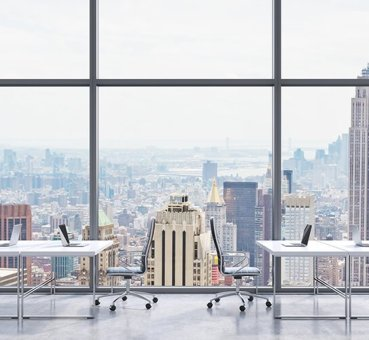 Image of a coworking spot in a high-rise with a view over Lower Manhattan