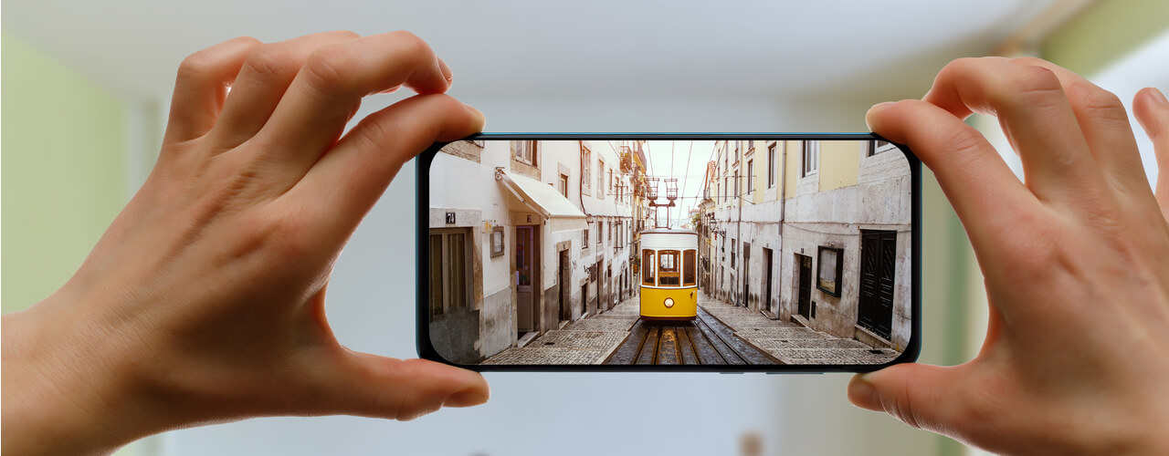 A man taking a virtual tour on his phone