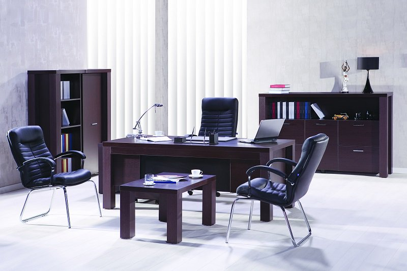 Private office with desk and chairs