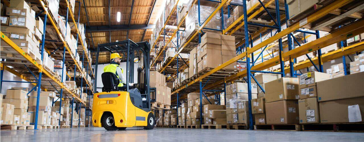 man on forklift in a warehouse